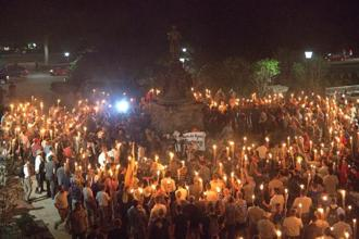 White nationalists carry torches on the grounds of the University of Virginia on 11 August. Photo: Reuters