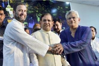 (From left to right) Congress vice president Rahul Gandhi, JDU leader Sharad Yadav and CPM's Sitaram Yechury at the opposition parties meeting in New Delhi on Thursday. Photo: PTI