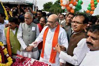 BJP president Amit Shah unveils the statue of Deen Dayal Upadhyay during his three-day visit to Bhopal on Friday. Photo: PTI