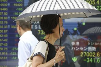 Volatility in Japan, South Korea and Hong Kong increased after a measure of market fluctuations spiked higher during US trading. Photo: AP