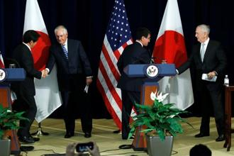 Japan's defence minister Itsunori Onodera (L-R), US secretary of state Rex Tillerson, Japan's foreign minister Taro Kono and US defence secretary James Mattis shake hands at the end of a news conference after their US-Japan security talks at the State Department in Washington on Thursday. Photo: Reuters