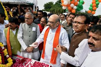 BJP president Amit Shah (centre) with Madhya Pradesh chief minister Shivraj Singh Chouhan (right) and state party president Nand Kumar Singh Chouhan (left) at an event in Bhopal on Friday. Photo: PTI