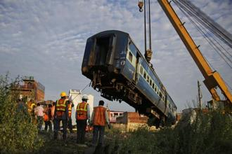 A coach of the Kalinga-Utkal Express being removed from the tracks after an accident near Khatauli, in Uttar Pradesh. Photo: AP