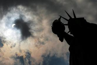 The solar eclipse is seen over Liberty State Island in New York on Monday. Reuters