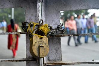 A lock is seen at the gate of a SBI branch in Shimla during All India Bank Employees Association (AIBEA)'s nationwide strike on Tuesday. Photo: PTI