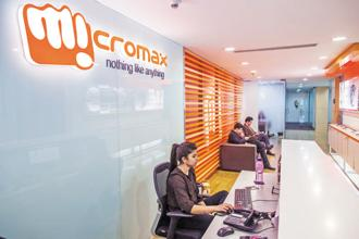 Micromax is focussing on strengthening its position in the Rs9,000-15,000 category and aims to garner 10% share in the category over the next six months. Photo: Bloomberg