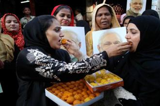 Muslim women celebrate the Supreme Court verdict on triple talaq in Mumbai on Tuesday. Photo: PTI