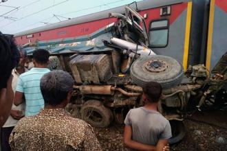 A sand dumper trespassing railway tracks caused derailment of Kaifiyat Express in Auriya, Uttar Pradesh on Wednesday. AFP