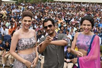 Bollywood actors Nawazuddin Siddiqui, Bidita Bag and Shraddha Das during the promotion of their upcoming film 'Babumoshai Bandookbaaz' in Bhopal on Wednesday. Photo: PTI Photo
