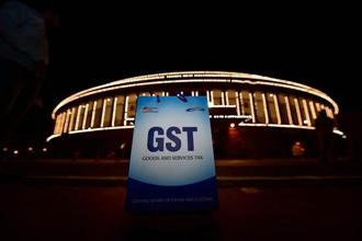 Uncertainty over how smoothly GST will be implemented remains large and tough to forecast, says Reuters survey. Photo: PTI