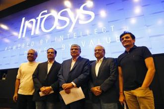 Infosys board members after appointment of Nandan Nilekani (centre) as the chairman of the company. The share buyback price of Rs1,150 is higher than the current stock trading price of Rs941.15. Photo: AP