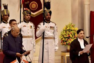 President Ram Nath Kovind administers oath to the new Chief Justice of India Dipak Misra at Rashtrapati Bhavan in New Delhi on Monday. Photo: PTI