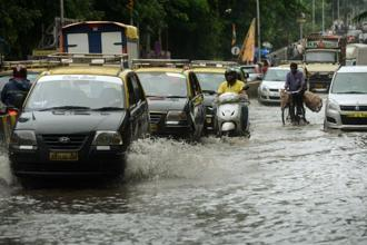 Schools and colleges in Mumbai will remain shut today and only those employees handling critical tasks in government offices need to go to work. Photo: AFP