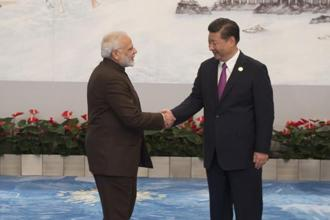 Chinese President Xi Jinping (right) welcomes Prime Minister Narendra Modi for a banquet dinner during the BRICS Summit in Xiamen, on Monday. Photo: AFP