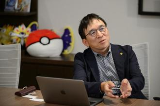 """We've only accomplished 10% of what Pokémon and Niantic are trying to do, so going forward we will have to include fundamental Pokémon experiences such as Pokémon trading and peer-to-peer battles,"" said Tsunekazu Ishihara. Photo: Bloomberg"