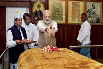 Narendra Modi visited the grave of Bahadur Shah Zafar on Thursday and paid floral tributes. Photo: PTI