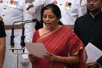 BJP leader and member of Parliament Nirmala Sitharaman takes the oath during the swearing-in ceremony of new ministers at the Presidential Palace in New Delhi on Sunday. Photo: Reuters
