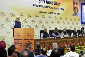 BJP national president Amit Shah addressing at an interactive session with FICCI in New Delhi on Saturday. Photo: PTI