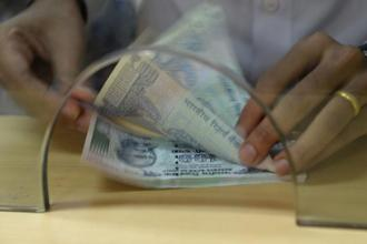 The rupee opened at 63.98 a dollar and touched a high and a low of 63.94 and 64.05, respectively. Photo: AFP