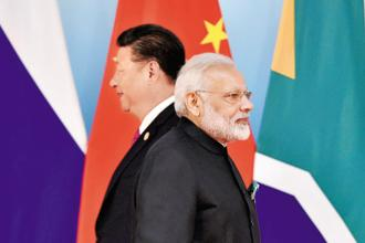 Chinese President Xi Jinping (left) and Indian Prime Minister Narendra Modi at the BRICS summit in Xiamen, China. Photo: AP
