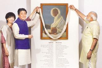 Prime Minister Narendra Modi with his Japanese counterpart Shinzo Abe and his wife Akie Abe at Sabarmati Ashram, in Ahmedabad on Wednesday. Photo: PTI
