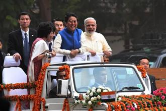 Japanese Prime Minister Shinzo Abe (centre) and his wife Akie Abe (left) with PM Narendra Modi during their roadshow in Ahmedabad on Wednesday. Photo: AFP