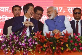 Prime Minister Narendra Modi and Japanese PM Shinzo Abe share a light moment during the launch of India's first bullet train between Ahmedabad and Mumbai on Thursday. AP
