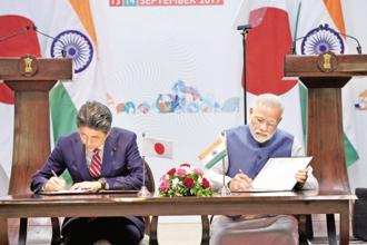 Japanese PM Shinzo Abe and India's Narendra Modi at the India-Japan Annual Summit in Gandhinagar on Thursday. Photo: PTI