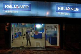File photo. A worker cleans a mobile store of Reliance Communications Ltd. Photo: Reuters/ Rupak De Chowdhuri