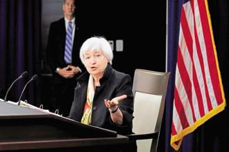 In her press conference, US Federal Reserve chief Janet Yellen will probably avoid wading too far into a growing debate over why inflation has failed to pick up despite low unemployment. Photo: Bloomberg