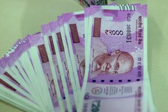 The rupee sank as much as 0.9%, the most since 18 May, to 64.84 per dollar, before closing down 0.8% at 64.7950. Photo: Hemant Mishra/Mint