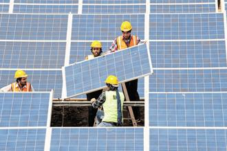 The poor quality of these used Chinese solar modules will affect solar power generation in India. Photo: AFP