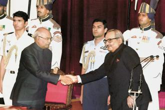 President Ram Nath Kovind (left) with Rajiv Mehrishi after the latter took oath as the CAG of India on Monday. Photo: HT