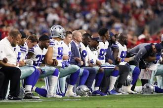 Members of the Dallas Cowboys link arms before the national anthem at the start of the NFL game against the Arizona Cardinals in Glendale. AFP