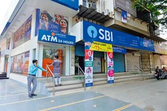 SBI has the highest number of account holders (420.4 million) in the country, covering more than a third of India's population. Photo: Aniruddha Chowhdury/Mint