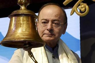 Finance minister Arun Jaitley rings a bell at the launch of a CSR project of Axis Bank in New Delhi. Photo: PTI