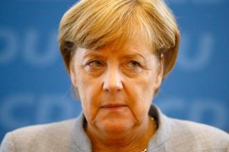 Angela Merkel's conservative group saw its number of seats axed to 246 from 309 previously, in its worst poll showing in seven decades. Photo: Reuters