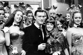 Hugh Hefner, publisher and owner of Playboy Magazine, and his girlfriend Barbara Benton are surrounded by Bunny Girls at the Playboy Club in London on 5 September 1969. File photo: AP