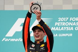 Red Bull driver Max Verstappen of the Netherlands holds his trophy aloft as he celebrates after winning the Malaysian Formula One Grand Prix at the Sepang International Circuit in Sepang, Malaysia on Sunday. Photo: AP