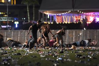 People run from the Route 91 Harvest country music festival after apparent gun fire was heard in Las Vegas on Monday. Photo: AFP