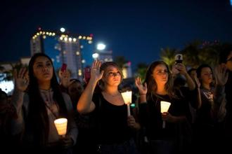 Mourners pledge to spread peace and love as they attend a vigil for the victims of Sunday night's mass shooting in Las Vegas, Nevada. AFP