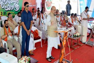 BJP National President Amit Shah speaks at the launch of the party's 'Janaraksha Yathra' at Payyannur in Kannur on Tuesday. Photo: PTI