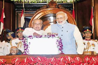 Then President Pranab Mukherjee and Prime Minister Narendra Modi at the midnight launch of the goods and services tax (GST) on 1 July 2017. Photo: PIB