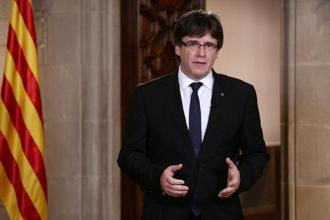 Catalan president Carles Puigdemont makes a statement at Generalitat Palace in Barcelona, Spain.