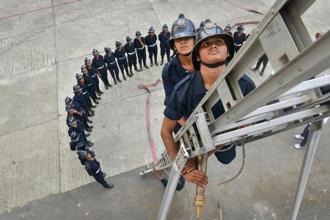 A training drill for firewomen at the Wadala fire station. Photographs by Aniruddha Chowdhury/Mint