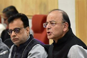 Finance minister Arun Jaitley (right) and revenue secretary Hasmukh Adhia during the GST Council meeting on Friday. Photo: PTI