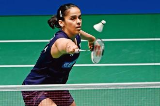 Saina Nehwal hits a return during her second round match at the Japan Open Badminton Championships against Carolina Marin on 21 September. Photo: AFP