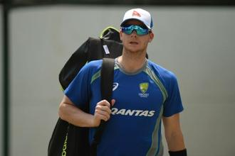 Steve Smith hurt his right shoulder diving in the field during the fifth and final one-day international against India. Photo: AFP