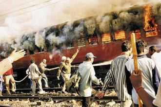 Coach S-6 of the Sabarmati Express, in which 59 people, mostly 'kar sevaks' returning from Ayodhya were travelling, was burnt on 27 February 2002 at the Godhra station, triggering riots in the state. Photo: AP