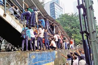 On 29 September, 23 people were killed in the rush hour stampede on a narrow overbridge linking Elphinstone Road and Parel suburban stations during heavy rain. Photo: PTI